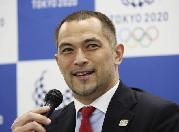 Tokyo 2020 Sports Director Koji Murofushi speaks during a press conference to unveil detailed Olympic competition schedule in Tokyo on Tuesday. For fans, athletes, and volunteers in Japan, next year's Olympics in Tokyo could become known as the get-up-early games. Organizers announced Tuesday that - hoping to beat summer heat in the Japanese capital - the men's 50-meter race walk final will begin at 5:30 a.m. The men's and women's marathon final will start at 6 a.m.