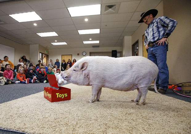 Mudslinger puts away his toys during a performance led by Top Hogs' John Vincent, right, Thursday, April 18, at the Summit County Library in Frisco.
