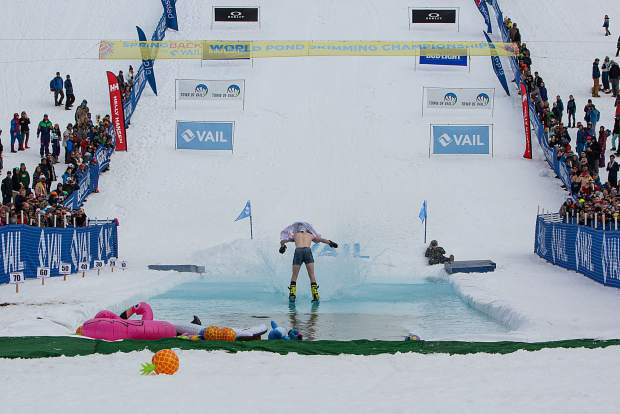 Battle Mountain High School senior Casey Cope skims the water in switch stance after hitting a jump into the water also in switch stance, a freeskiing maneuver known as a zero spin. The trick impressed judges enough to award Cope the First Place Male award at the World Pond Skimming Championships in Vail on Sunday.