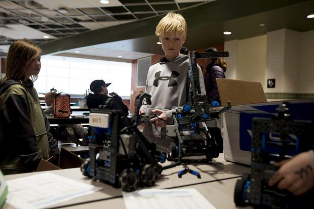 Local fourth-grader Malachi Love tests the remote controlled robot Wednesday, April 3, inside the school in Frisco.