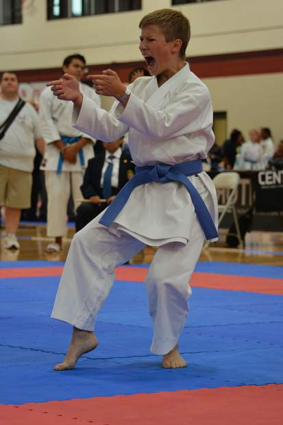 Sebastion Witt competes in forms at a recent karate tournament. The Eagle teen was recently named to the Amateur Athletic Union National Team and he will compete in international events in Hungary and Slovakia this summer.