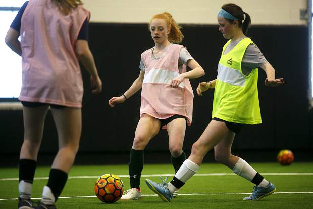 Members of the Summit High School girls soccer program practice on Tuesday, April 2 inside the school's new indoor turf at Summit High School near Frisco.