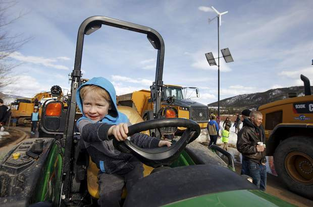 Theo Hahn, 4, of Silverthorne, explores the driver's seat on a tractor during the