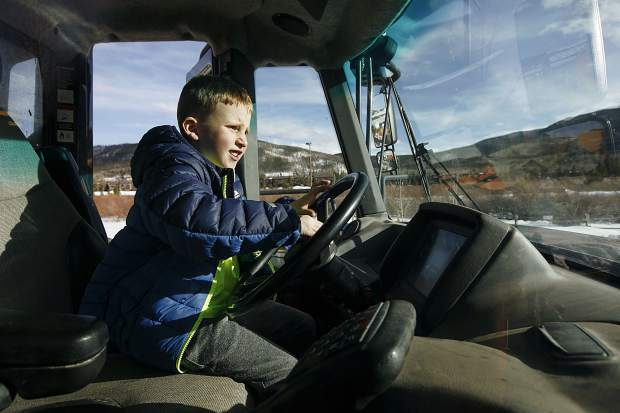Michael Clement, 7, of Frisco, explores the driver's seat of heavy machinery equipment used for the