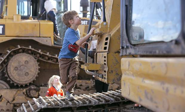 Children climb on the heavy machinery used for the
