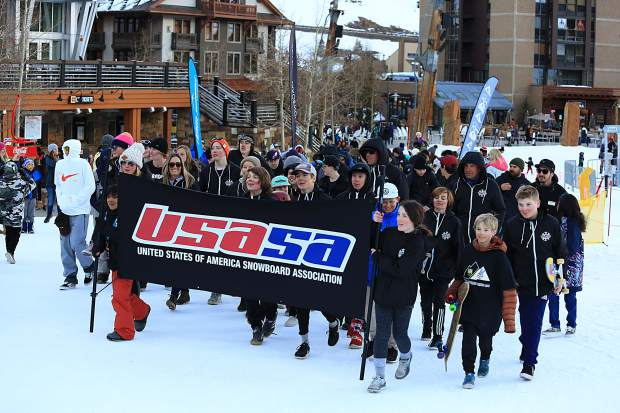 Snowboarders march through Copper Mountain Resort's Center Village as part of a ceremony to ring in the 2019 USASA Nationals at Copper Mountain Resort. This week's snowboard national championship competitions wrapped up Thursday, while  freeski competitions will take place next week.