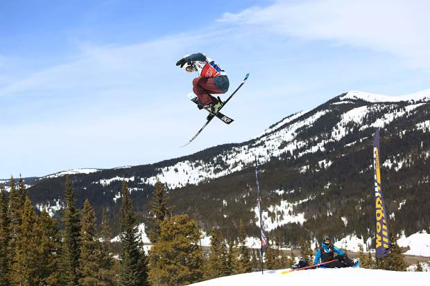 A freeskier rises above the Copper Mountain snow during competition this week at the USASA National Championships at Copper Mountain Resort, the TenMile Range in view in the distance.