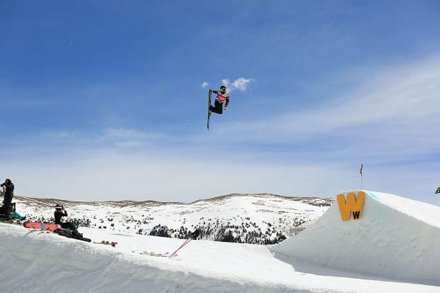 A freeskier grabs a ski on a jump on the slopestyle course during competition this week at the USASA National Championships at Copper Mountain Resort.