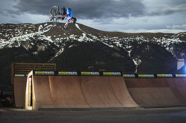 Professional BMX rider Matt Olson soars above a Woodward Copper park at Copper Mountain Resort, the TenMile Range in view at rear.