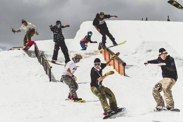 Members of the Shredbots snowboard crew ride through Woodward Copper's summertime Pipeline Park terrain park at Copper Mountain Resort.