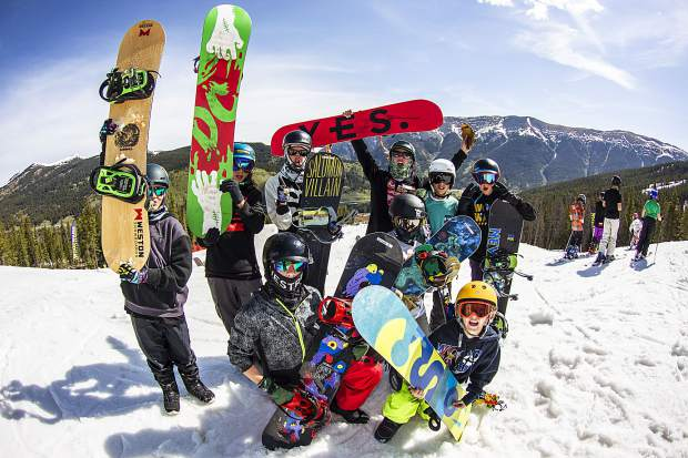 Woodward Copper snowboard campers pose for a group photo on snow at Copper Mountain Resort.