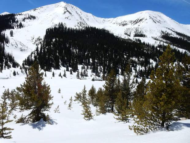 Cabins at the Independence ghost town were spared from avalanches from surrounding peaks this winter.