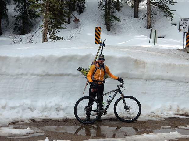 Greg Albrecht stands at the entrance to Lincoln Gulch while cycling and later skinng up Independence Pass on Thursday.
