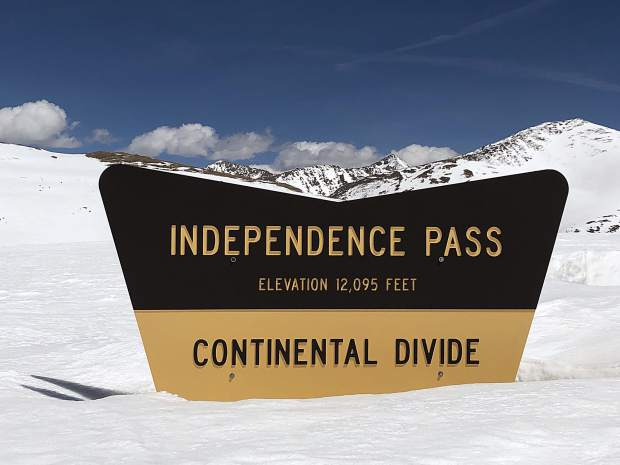 The summit sign for Independence Pass sticks up from the snow. CDOT hopes to have Highway 82 open on May 23.