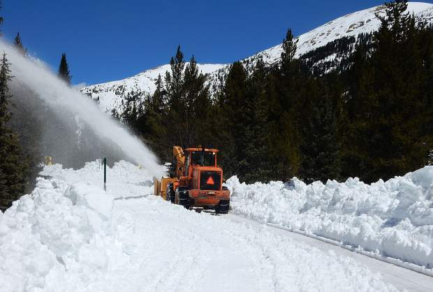 A CDOT grader with a snowblower in front chews through the snow just above the lower Lost Man parking lot and campground on Thursday.