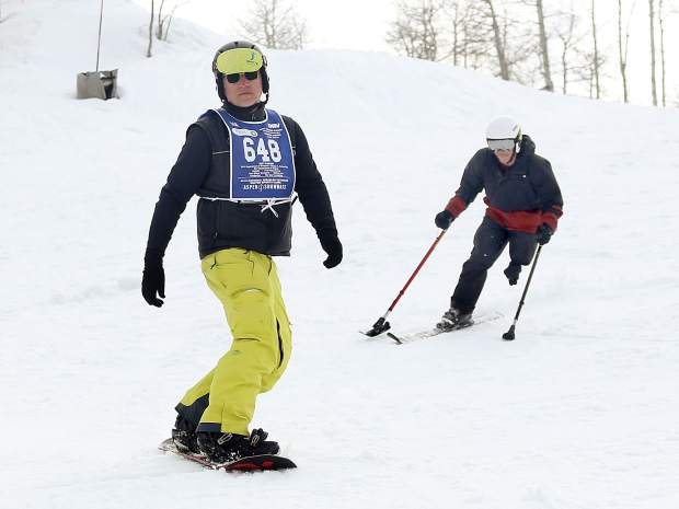 Instructor Paul Dowsett, left, and trainee George Kellogg take part in the National Disabled Veterans Winter Sports Clinic in Snowmass on Wednesday.