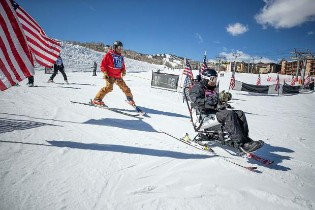 Robert Morrs skis down on the electric tetraski at the National Disabled Veterans winter sports clinic at Snowmass on April 1.