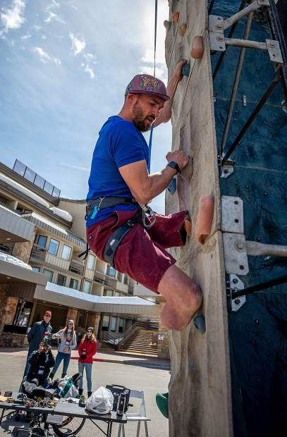Medic veteran Feet Jensen on the rock climbing wall outside of the Westin in Snowmass on April 1 for the National Disabled Veterans winter sports clinic.