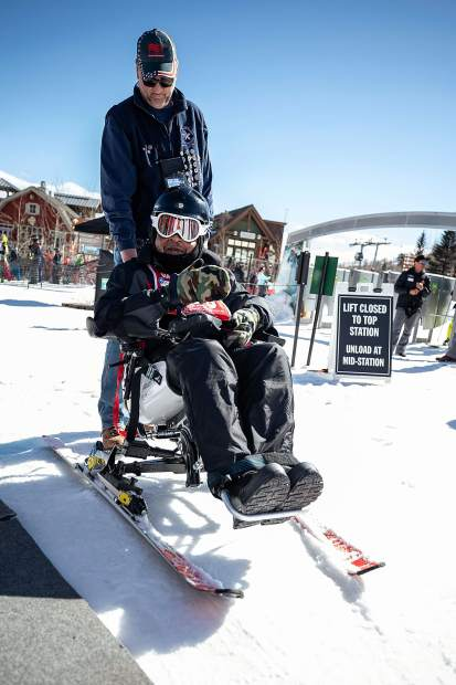Robert Morrs on the electric tetraski at the National Disabled Veterans winter sports clinic at Snowmass on April 1.