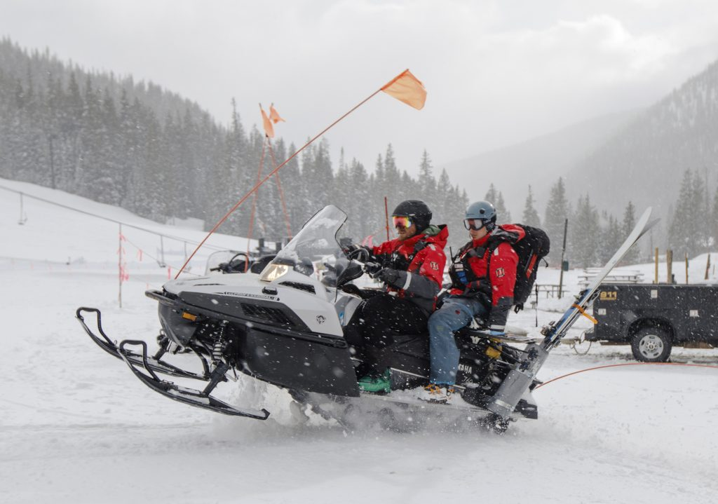 Summit County Rescue Group members Devon Haire, left, and Tyler McGuire set out to search for lost snowboarder John Moser Tuesday evening, May 21, at Arapahoe Basin Ski Area.