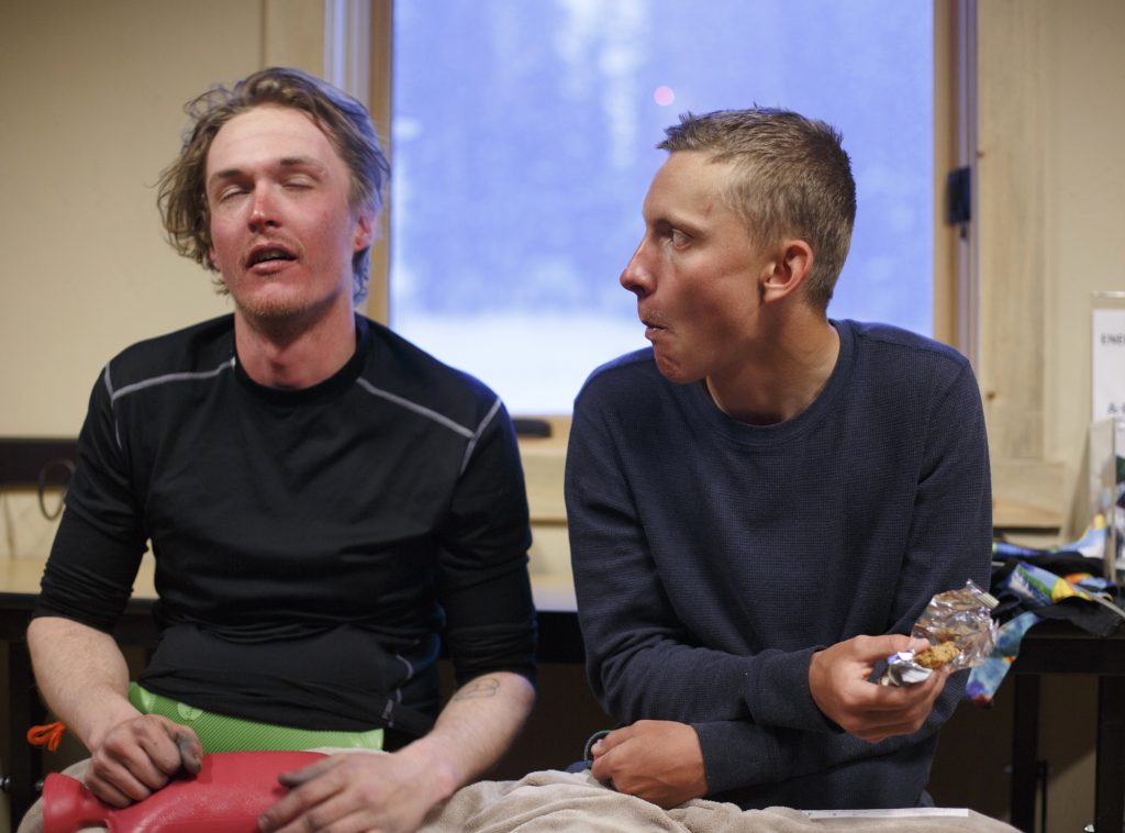 Snowboarder John Moser, left, catches his breath next to his friend Patrick Powers after being rescued Tuesday evening, May 21, at Arapahoe Basin Ski Area. Moser, who was found by Summit County Rescue Group, was swept by an avalanche as he and Powers were attempting to hike back inbounds.