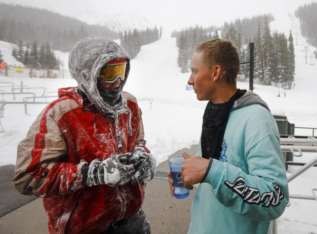 Snowboarders John Moser, left, and Patrick Powers interact after Moser was rescued Tuesday evening, May 21, at Arapahoe Basin Ski Area. Moser, who was found by Summit County Rescue Group, was swept by an avalanche as he and Powers were attempting to hike back inbounds.