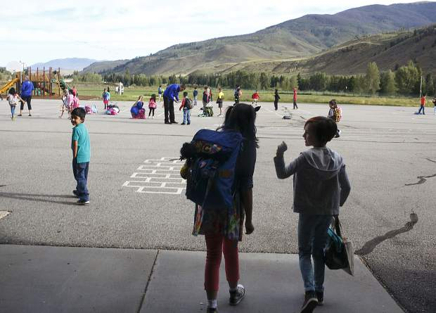 Silverthorne Elementary students Kyah Quam, left, and Grace Gardner chat as they arrive to the school's playground on Thursday, Aug. 24, as part of before-school festivities to commemorate the first day.