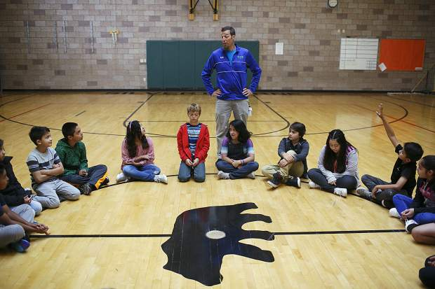 Silverthorne Elementary physical education teacher Tyler Bunnelle leads their first gym class, directing students to reposition themselves into girl-boy format.