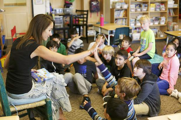 Silverthorne Elementary teacher Liz McFarland high-fives a student during her new fifth-grade class's first day Thursday, Aug. 24.