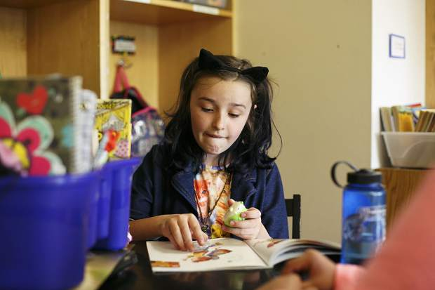 Silverthorne Elementary student Kyah Quam paws through a book during class Thursday, Aug. 24.