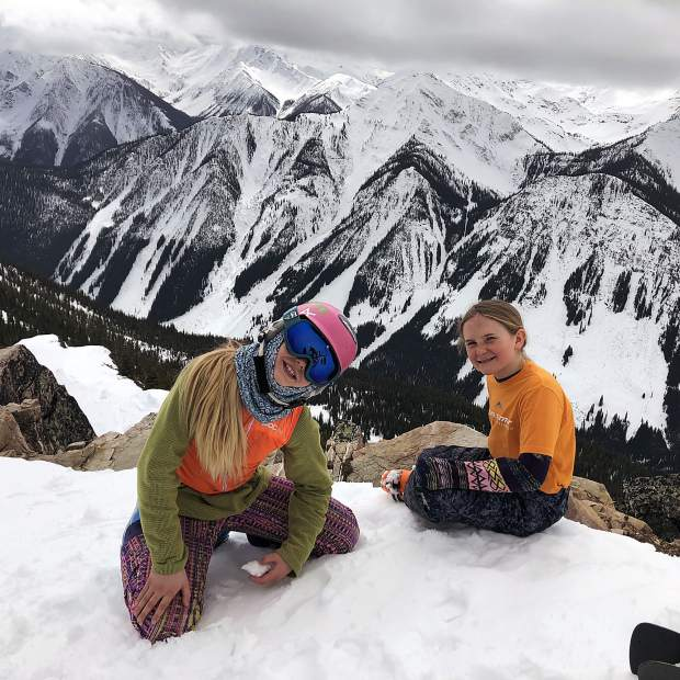 Summit County local 10-year-old freeskiers Hannah Webb (left) and Maddie Haser pose for a photograph on a ridgeline at the IFSA North American Freeride Championships at Kicking Horse Mountain Resort in Canada last month.