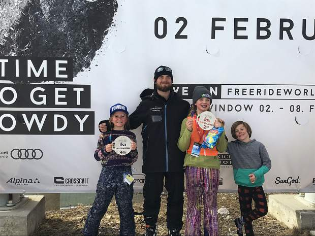 Maddie Haser (left) and Hannah Webb (second from right) pose for a photo with their Team Summit freeski coach Alex Debonville and Haser's little brother Jaxon (far right) during the podium ceremony at last month's IFSA North American Freeride Championship at Kicking Horse Mountain Resort in Canada.