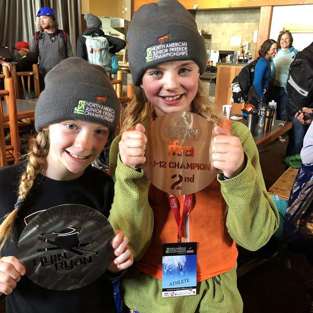 Team Breckenridge U-12 big mountain freeskier Riley Combe (left) poses with her