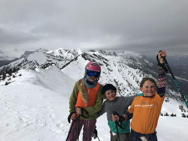 Summit County local 10-year-old freeskiers Hannah Webb (left) and Maddie Haser (right) pose for a photograph with Haser's 8-year-old brother and fellow big mountain freeskier Jaxon (center) at the IFSA North American Freeride Championships at Kicking Horse Mountain Resort in Canada last month.