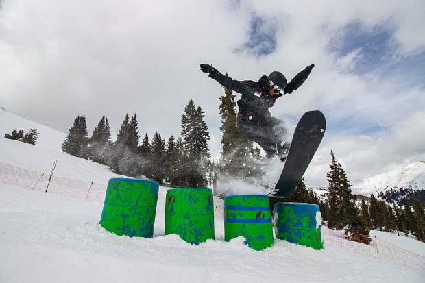 A snowboarder rides through Arapahoe Basin Ski Area's Treeline Terrain Park in February.