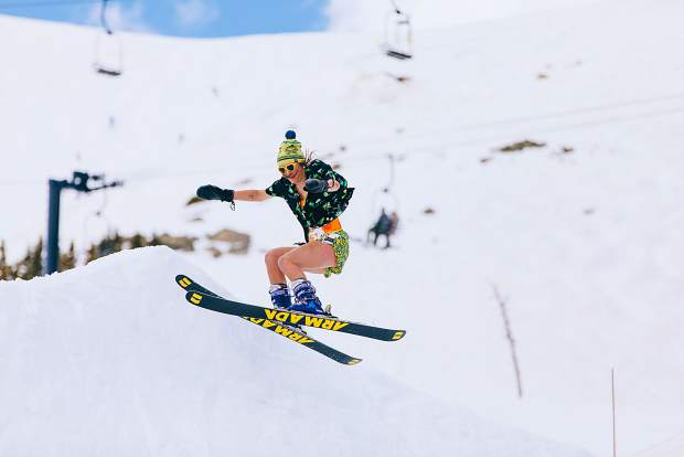 A skier spots her landing during a spring rail jam last year at Arapahoe Basin Ski Area.