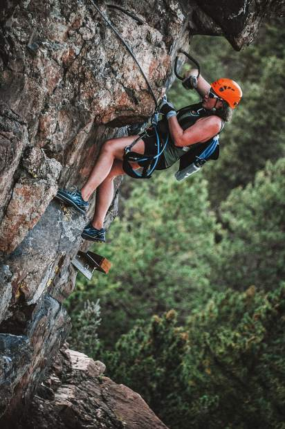A climber traverses AVA Rafting & Zipline's Granite Via Ferrata course in Buena Vista last summer.
