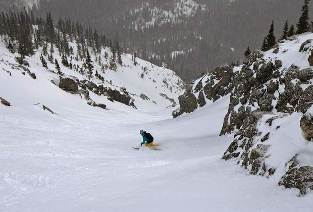Halfway down the Silver Couloir, skier Manasseh Franklin does dozens of turns on fresh snow on April 13, on Buffalo Mountain near Silverthorne.