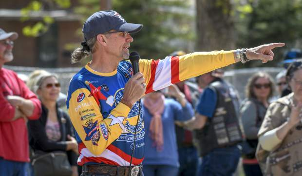 Former NASCAR driver Kyle Petty directs riders for a commemorative photo in front of Hotel Colorado Sunday afternoon. The Charity Ride bought out the hotel for the night as it travels across the country raising money for Victory Junction.