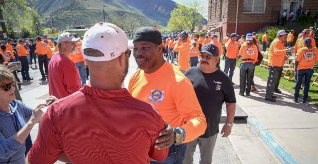 Former NFL great and Heisman Trophy winner Herschel Walker meets fans during the Kyle Petty Charity Rides stop in Glenwood Springs Sunday.