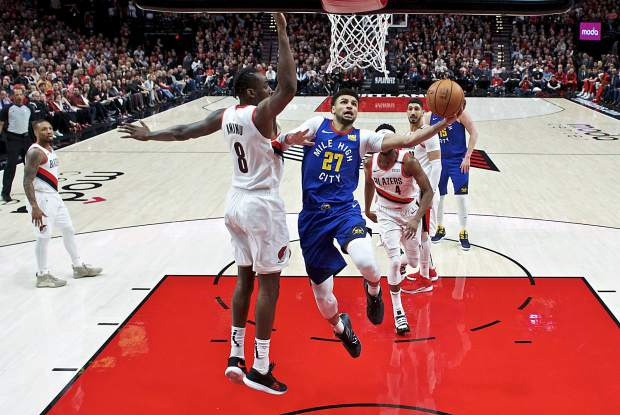 Denver Nuggets guard Jamal Murray, right, shoots over Portland Trail Blazers forward Al-Farouq Aminu during the second half of Game 3 of an NBA basketball second-round playoff series on May 3 in Portland, Oregon.