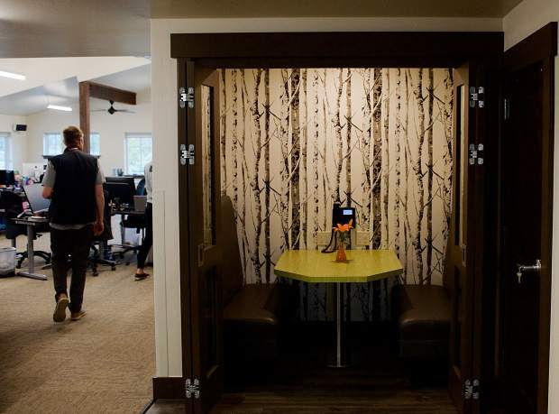 A number of multifunctional spaces have been programmed into the Tieken Place at Keystone Science School, including this phone-booth style cubby by The Mind Field that's nice for small group meetings and taking calls.