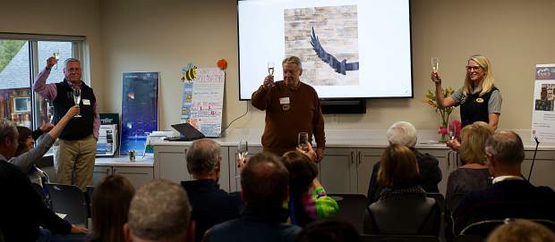 From left, Howard Carver, Doug Sims and Ellen Reid host a toast inside the Carver Teaching Lab during a grand opening celebration for a new 5,900-square foot facility Thursday at Keystone Science School. Reid is the school's executive director, and Carver and Sims are longtime supporters who were critical parts of a capital campaign that raised $3.95 million to pay for the improvements.