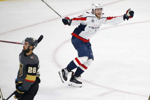 Washington Capitals center Lars Eller, right, celebrates his goal as Vegas Golden Knights left wing William Carrier skates away during the third period in Game 5 of the NHL hockey Stanley Cup Finals in Las Vegas last June. Paying the bills, going out to dinner and cutting the grass can fall by the wayside for NHL players on long playoff runs. With so much focus on hockey, everything on the outside is forgotten about this time of year.