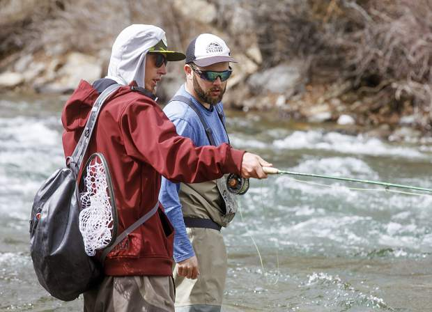 Trent Jones of Frisco, left, a fly-fishing guide for Cutthroat Anglers in Silverthorne, instructs Summit Daily sports & outdoors editor Antonio Olivero while nymphing on the Blue River in Silverthorne on Wednesday, May 8.