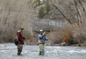 Master fly fisherman schools Summit Daily editor on a surging and swift Blue River