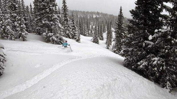 A skier carves fresh turns at Breckenridge Ski Resort Tuesday morning after a spring snow storm dropped 9 inches overnight at the resort along the slope of Summit County's TenMile Range. This year is Breckenridge's first spring remaining open through Monday's Memorial Day holiday as part of a month-long celebration event dubbed