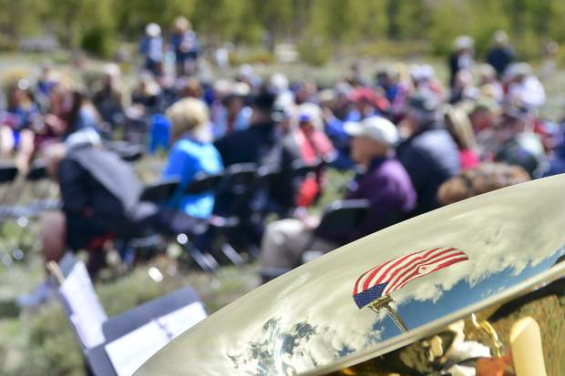 The American Flag is reflected in Warren Van Kampen's tuba during the Memorial Day Ceremony on Monday at Dillon Cemetery. Van Kampen was playing with the Summit Concert Band.
