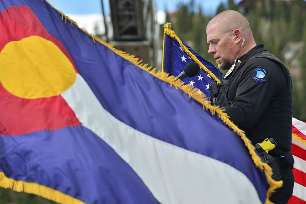 Sgt. Cale Osborn of the Dillon Police Department reads the names of the 52 service members killed in action and interred at Dillon Cemetery during the town's Memorial Day remembrance ceremonies.