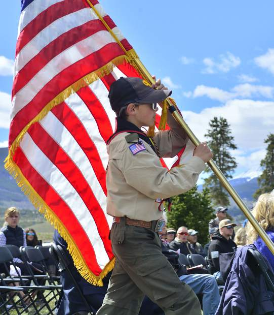 Aiden Chambers, of Boy Scout Troop 188 carries the flag into Monday's Memorial Day Ceremony in Dillon.